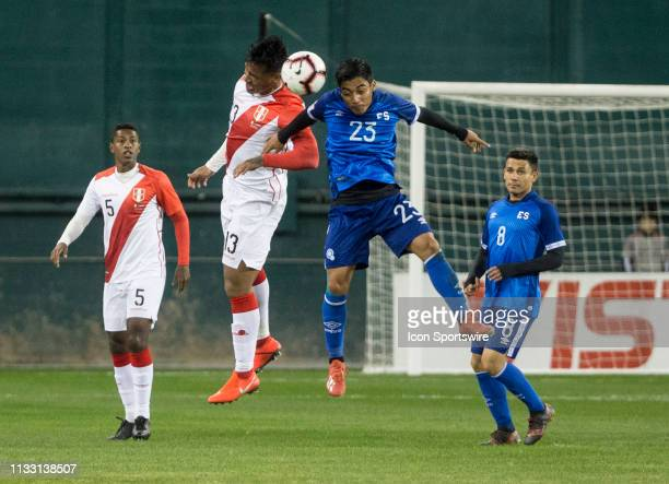 Renato Tapia and Diego Coco go up for a header during an international friendly match between Peru and El Salvador on March 26 at RFK Stadium in...