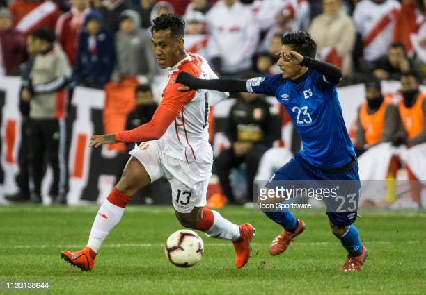 Renato Tapia dribbles around Diego Coco during an international friendly match between Peru and El Salvador on March 26 at RFK Stadium in Washington...