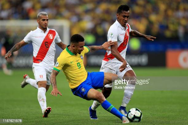 Renato Tapia of Peru fights for the ball with Gabriel Jesus of Brazil during the Copa America Brazil 2019 group A match between Peru and Brazil at...