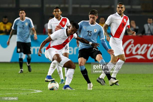 Renato Tapia of Peru struggles for the ball with Federico Valverde of Uruguay during a friendly match between Peru and Uruguay at Estadio Nacional de...