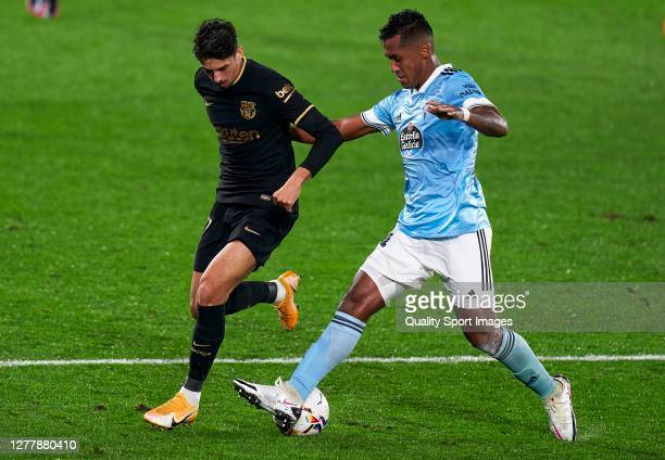Renato Tapia of RC Celta competes for the ball with Francisco Trincao of FC Barcelona during the La Liga Santander match between RC Celta and FC...