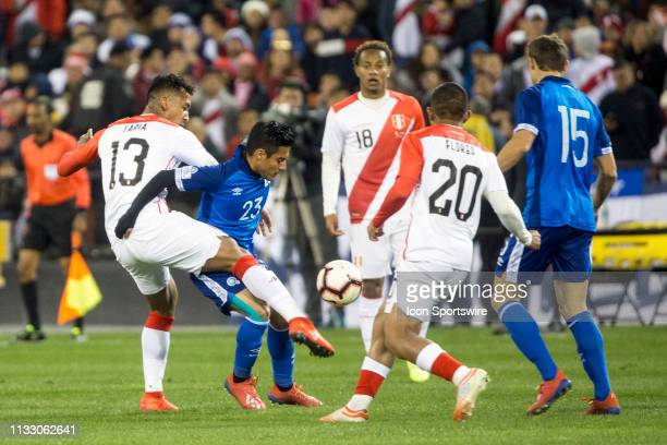 Renato Tapia tackles Diego Coco during an international friendly match between Peru and El Salvador on March 26 at RFK Stadium in Washington DC