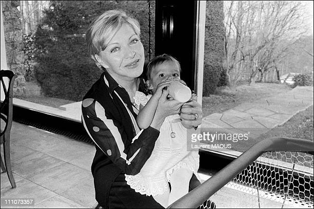 L Renaud and L Gast with Michelle their godchildren on the day of his baptism in France on February 01 1977