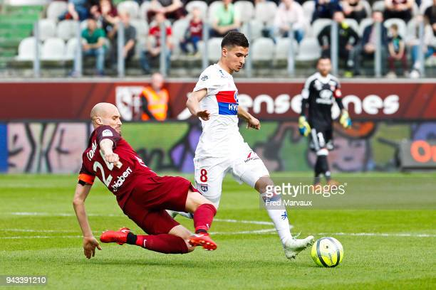 Renaud Cohade of Metz and Houssem Aouar of Lyon during the Ligue 1 match between Metz and Olympique Lyonnais at on April 8 2018 in Metz