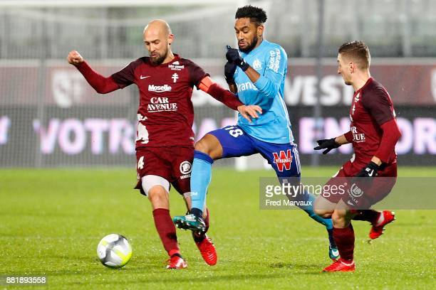 Renaud Cohade of Metz and Jordan Amavi of Marseille and Ivan Balliu of Metz during the Ligue 1 match between Metz and Olympique Marseille at Stade...