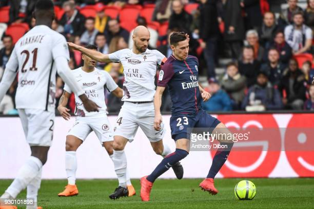 Renaud Cohade of Metz and Julian Draxler of PSG during the Ligue 1 match between Paris Saint Germain and Metz at Parc des Princes on March 10 2018 in...