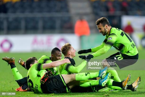 Renaud Emond forward of Standard Liege celebrates scoring a goal with PaulJose Mpoku forward of Standard Liege and Orlando Sa forward of Standard...