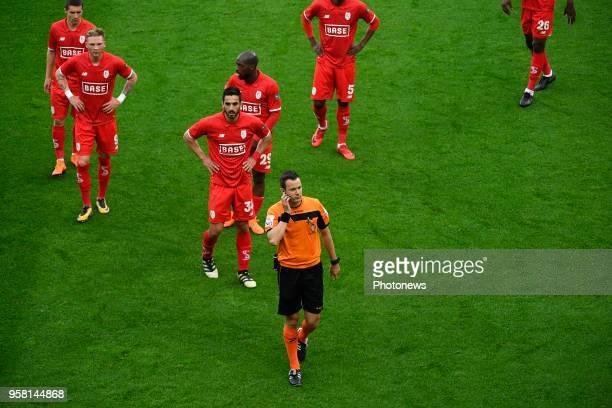 Renaud Emond forward of Standard Liege Pedro Luis Cavanda midfielder of Standard Liege Konstantinos Laifis defender of Standard Liege referee Van...
