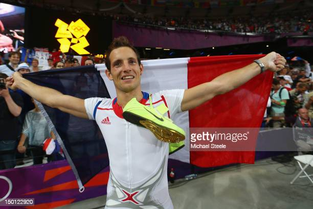 Renaud Lavillenie of France celebrates winning gold in the Men's Pole Vault Final on Day 14 of the London 2012 Olympic Games at Olympic Stadium on...