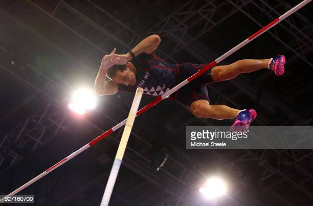 Renaud Lavillenie of France competes in the Men's Pole Vault Final during the IAAF World Indoor Championships on Day Four at Arena Birmingham on...