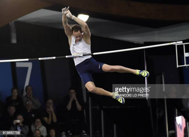 Renaud Lavillenie takes part in the men's pole vault event during the French Indoor Athletics Championships in Lievin on February 18 2018 / AFP PHOTO...