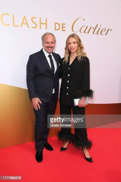 Renaud Lestringant Managing Director Cartier Northern Europe and Lena Klenke during the Clash de Cartier The Opera event at Eisbachstudios on October...