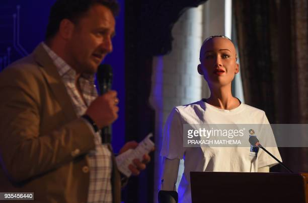 Renaud Meyer United Nations Development Programme Country Director for Nepal introduces humanoid robot Sophia at a conference on using technology for...