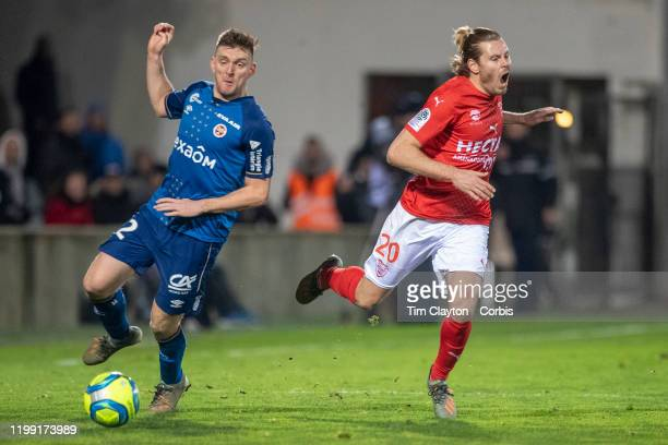 Renaud Ripart of Nimes defended b y Thomas Foket of Reims during the Nimes Olympique V Stade de Reims French Ligue 1 regular season match at Stade...