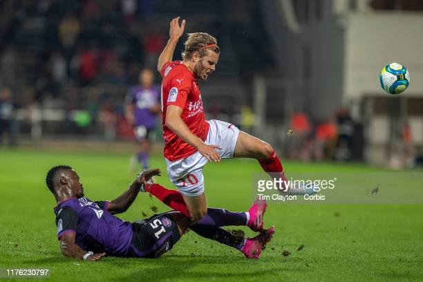 September 21: Renaud Ripart of Nimes is tackled by Nicolas Isimat-Mirin of Toulouse during the Nimes V Toulouse, French Ligue 1, regular season match...