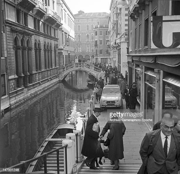 A Renault 4L car driving by a venitian canal in Bacino Orseolo Venice 1961