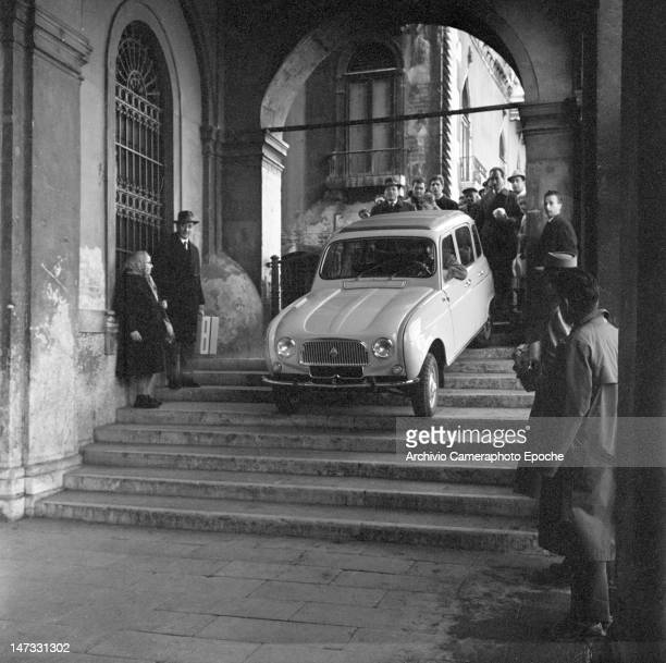A Renault 4L car getting down a bridge near Rialto Venice 1961