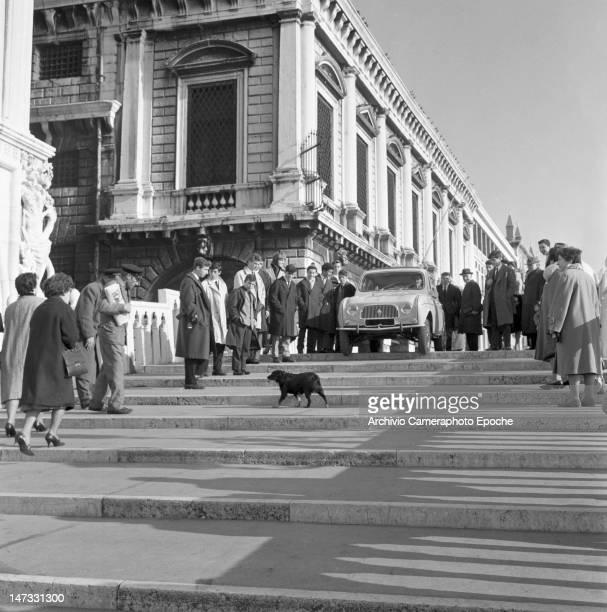 A Renault 4L car parked on the bridge called 'Ponte della Paglia' near 'Riva degli Schiavoni' Venice 1961
