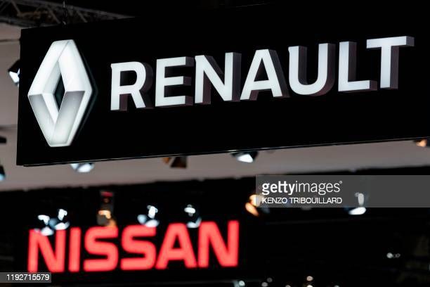 Renault and Nissan automobile logos are pictured during the Brussels Motor Show on January 9 2020 in Brussels