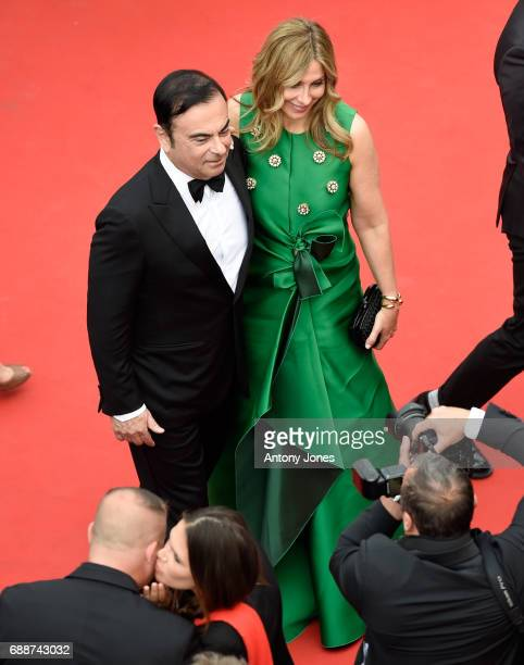 Renault CEO Carlos Ghosn and Carole Ghosn attend the Amant Double screening during the 70th annual Cannes Film Festival at Palais des Festivals on...
