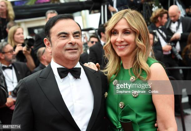 Renault CEO Carlos Ghosn and Carole Ghosn attend the Amant Double premiere during the 70th annual Cannes Film Festival at Palais des Festivals on May...