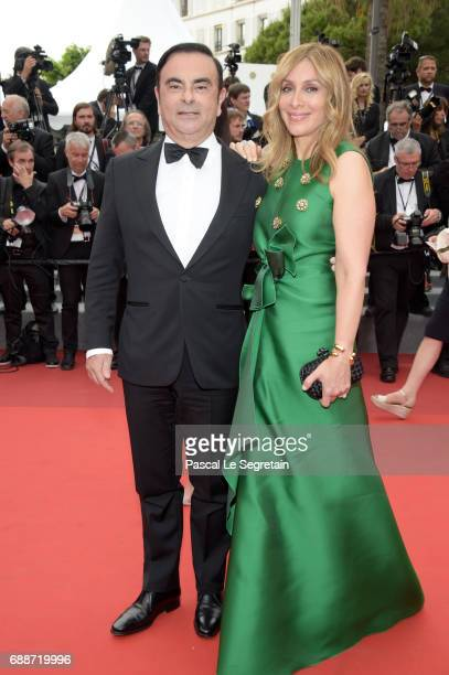 Renault CEO Carlos Ghosn and his wife Carole Ghosn attend Amant Double Red Carpet Arrivals during the 70th annual Cannes Film Festival at Palais des...