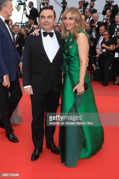 Renault CEO Carlos Ghosn and his wife Carole Ghosn attend the L'Amant Double screening during the 70th annual Cannes Film Festival at Palais des...