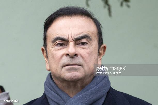 Renault CEO Carlos Ghosn waits for the French President to arrive for a visit of the Renault factory in Maubeuge northeastern France 08 November 2018...
