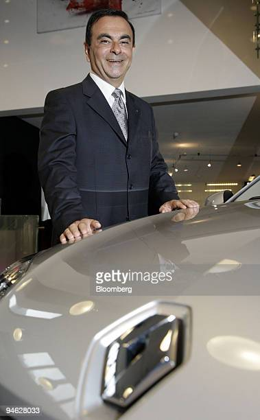 Renault Chief Executive Officer Carlos Ghosn poses next to a new Renault Laguna automobile in St Wolfgang Austria Wednesday Aug 29 2007 Renault SA...