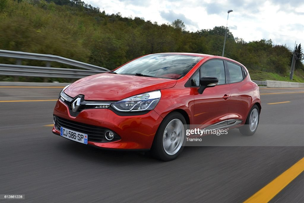 Renault Clio on the highway : Stock Photo