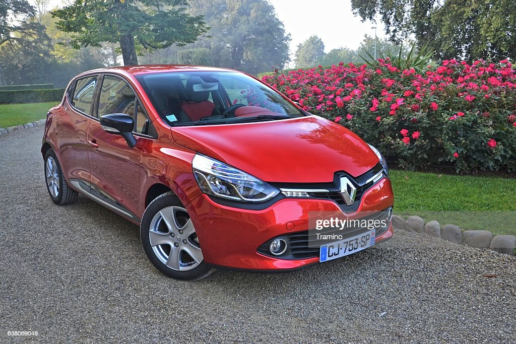 Renault Clio stopped on the road : Stock Photo