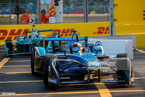 Renault edams driver Sebastien Buemi of Switzerland takes a corner during the Formula E motor racing championship in Hong Kong on December 2 2017 /...