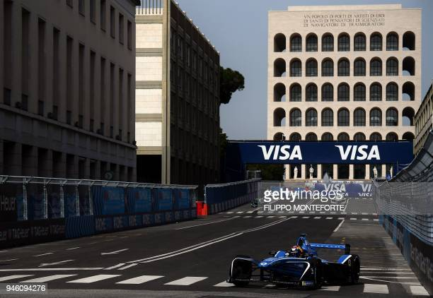 Renault edams racing Formula E team driver Switzerland's Sebastien Buemi steers his car past the Palazzo della Civilta Italiana during practice prior...