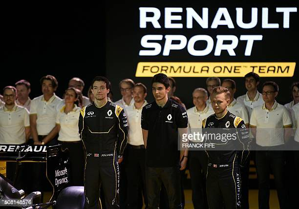 Renault F1 driver British Jolyon Palmer Renault F1 tests driver French Esteban Ocon and Danish Formula One driver Kevin Magnussen pose next to the...