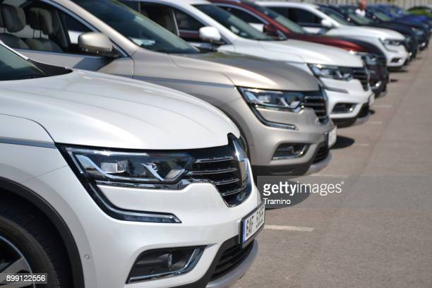 renault koleos suv cars on the parking - build grill stock photos and pictures