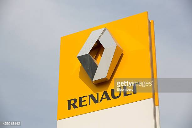 A Renault logo sits on display outside the Mosrentservis auto dealership for Renault SA in Moscow Russia on Friday Aug 1 2014 Renault SA part of the...
