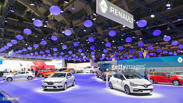 Renault motor show stand with Megane and Clio hatchback cars