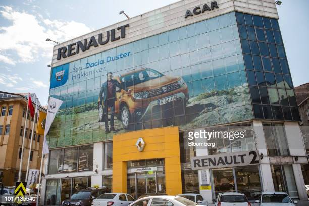 Vehicles for sale sit on display outside the Volkswagen AG automobile dealership in the Kasimpasa district of Istanbul Turkey on Wednesday Aug 14...