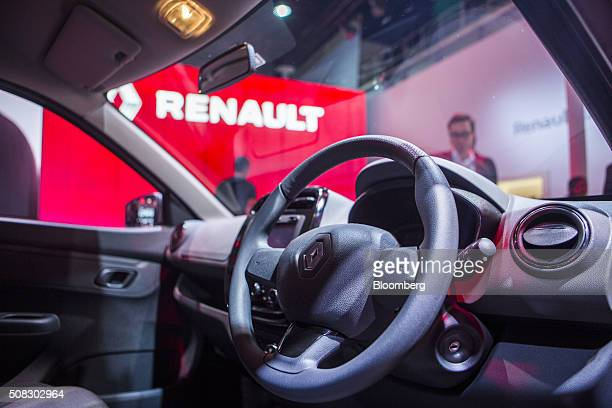A Renault SA badge is seen on steering wheel of the automaker's Kwid compact vehicle on display at the Auto Expo 2016 in Noida Uttar Pradesh India on...