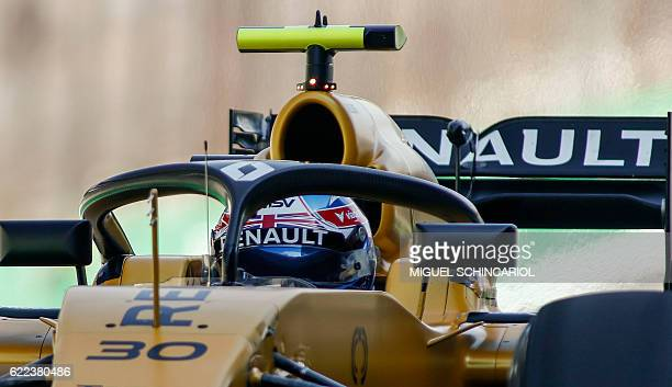 Renault Sport F1 Team's British driver Jolyon Palmer tests the socalled halo cockpit protection device during first practice session of the Formula...