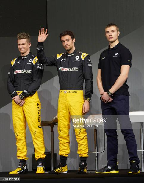 Renault Sport Formula One drivers Nico Hulkenberg Jolyon Palmer and Sergey Sirotkin pose during a launch event at the Royal Horticultural Halls in...