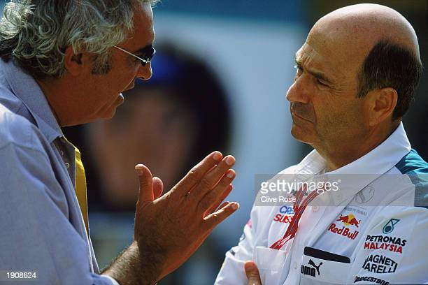 Renault team boss Flavio Briatore chats to Sauber team boss Peter Sauber during the Brazilian Formula One Grand Prix held on April 6, 2003 at...