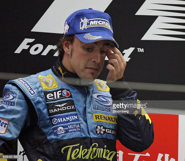 Renault team's Fernando Alonso of Spain wonders after finishing second in the Formula 1 Grand Prix of Shanghai in China Sunday October 1 2006 Michael...
