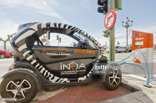 A Renault Twizy electric car gets its battery recharged at an Eon streetside charging station on the Santander seafront