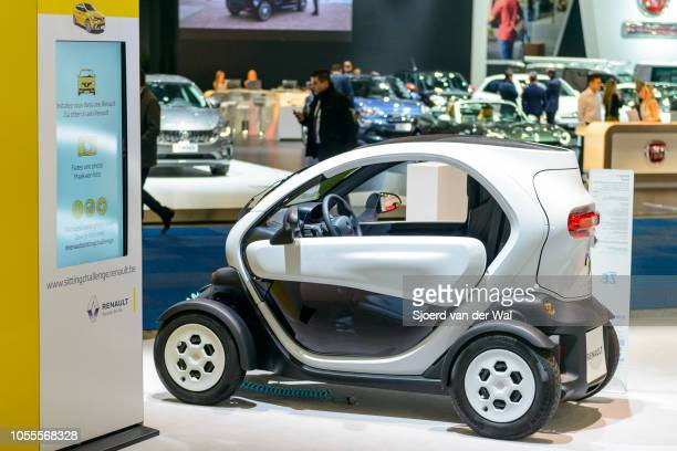 Renault Twizy electric compact city car charging at an electric vehicle charging station at the Renault stand on display at Brussels Expo on January...