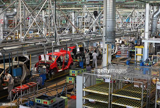 Renault vehicles move along the production line at the Renault factory in Valladolid Spain on Tuesday April 13 2010 Renault SA and Nissan Motor Co...