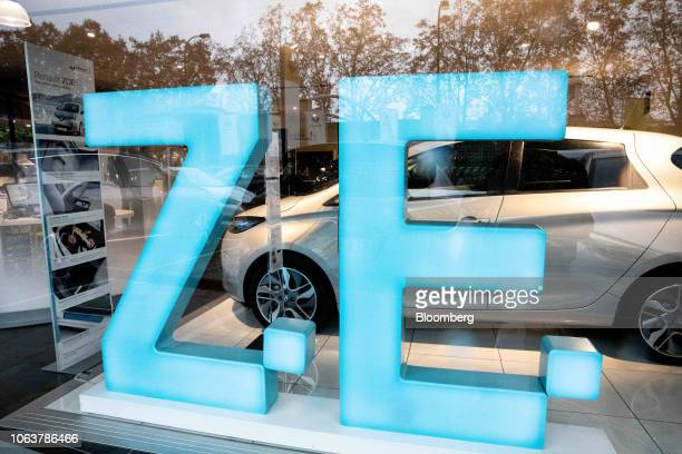 Renault Z.E. Logo for the automaker's all electric line of automobiles stands in a window at a Renault SA showroom in Paris, France, on Tuesday, Nov....
