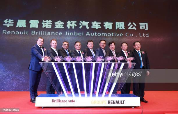 RenaultNissan Chairman and CEO Carlos Ghosn and Brilliance Auto Chairman Qi Yumin attend a signing ceremony of joint venture between Renault and...