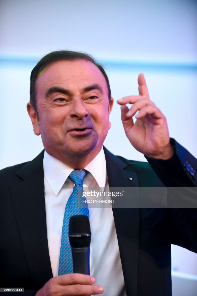 Renault-Nissan Chairman and CEO Carlos Ghosn gestures as he speaks during a press confrence on the Renault strategic plan 'Drive the Future 2017-2022', at la Defense business district, in Paris, on October 6, 2017. /