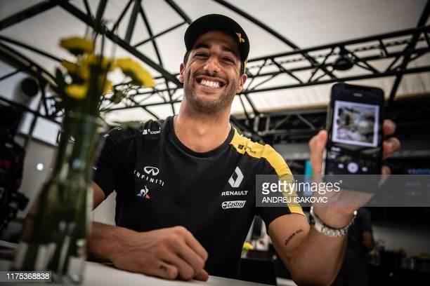 Renault's Australian driver Daniel Ricciardo displays his phone and favourite music play list ahead of the German Grand Prix in Hockenheim on July 25...